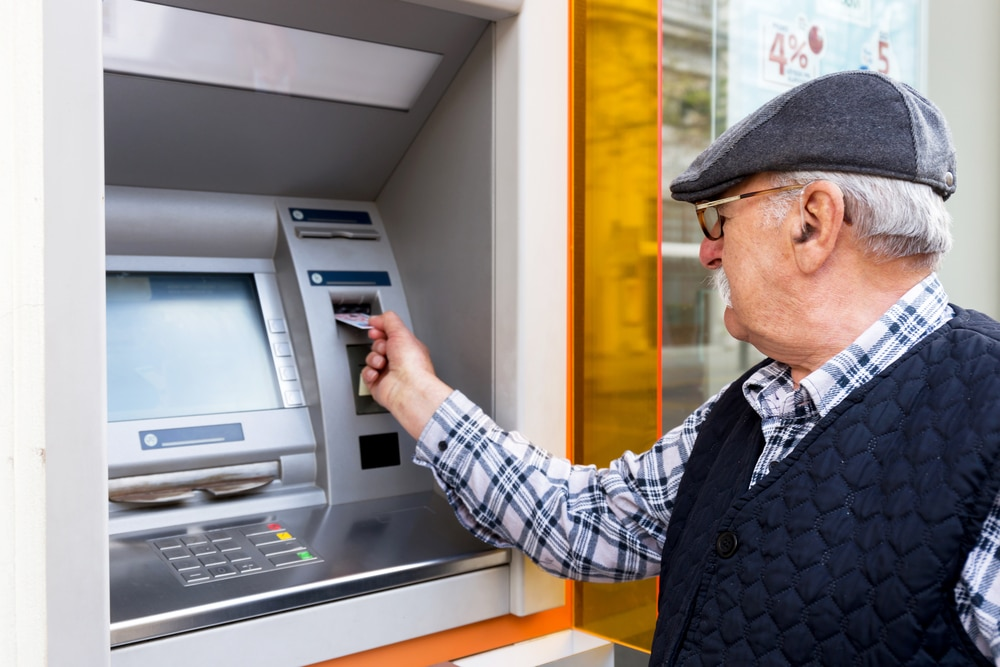 Senior withdrawing money from an ATM