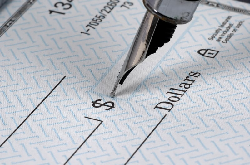 Blank check with fountain pen