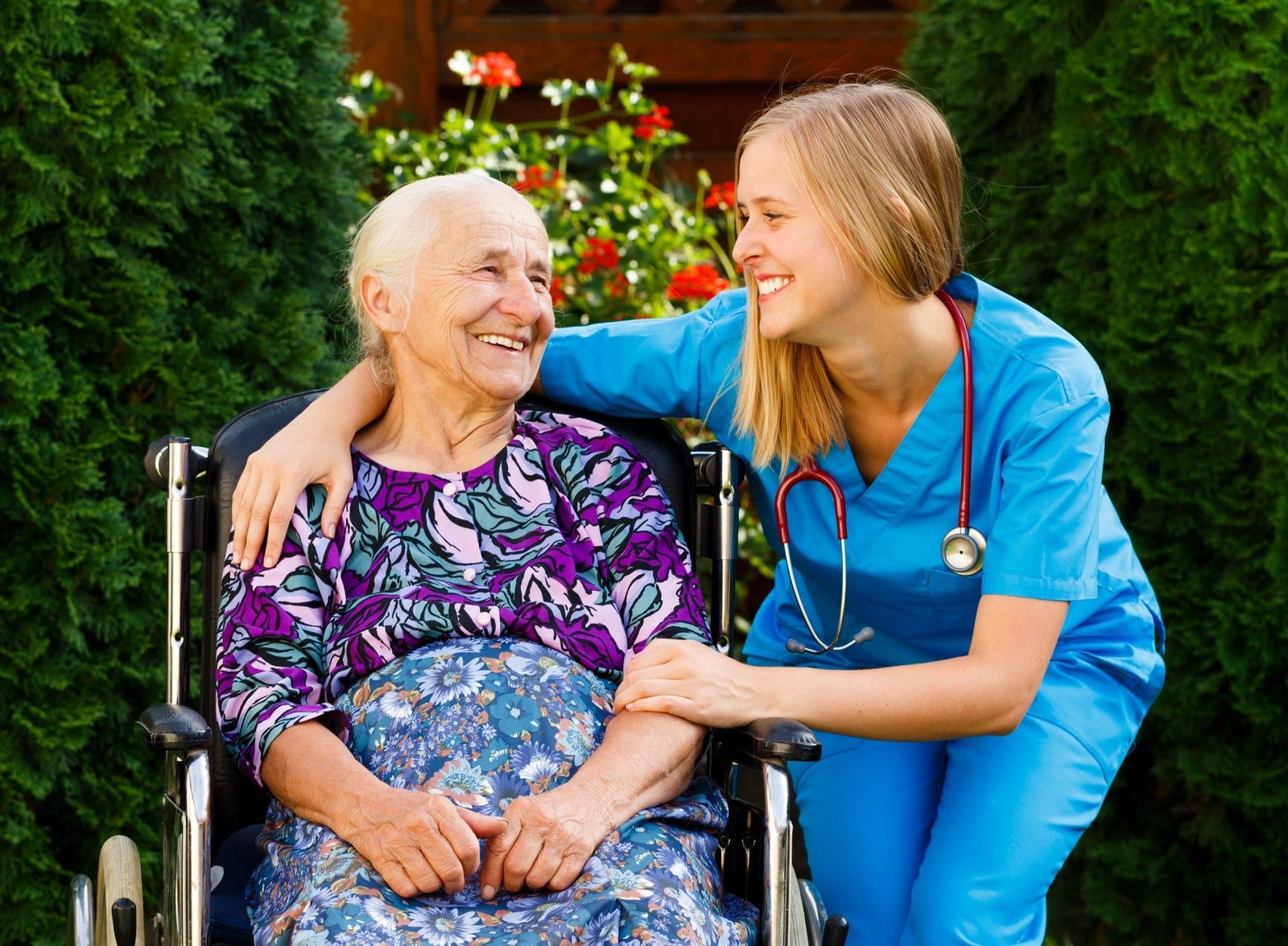Supporting young healthcare worker with elderly patient