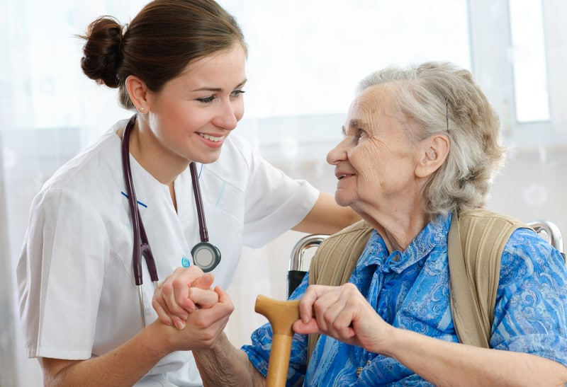 Senior woman with her in-home caregiver