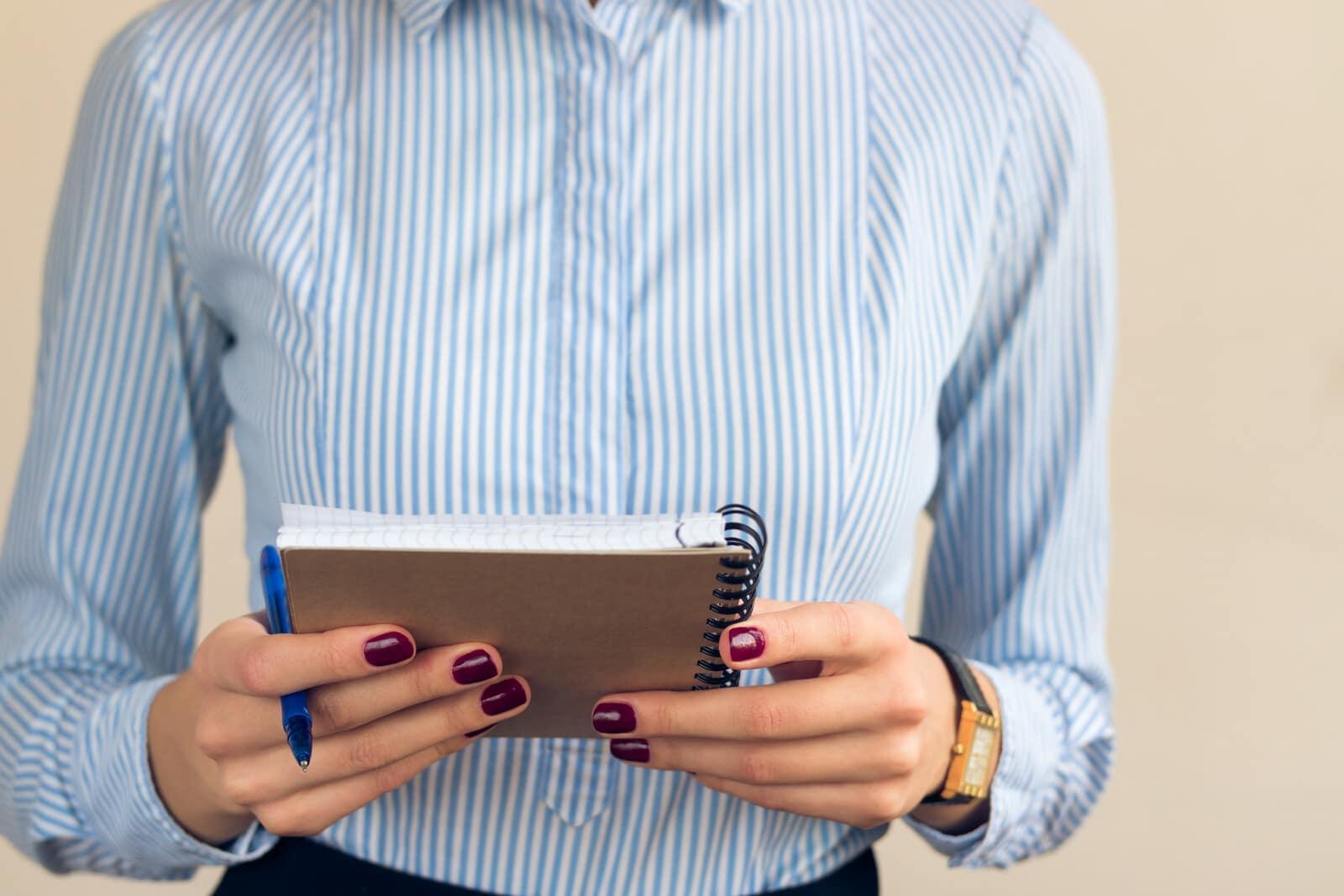 Lady holding checklist