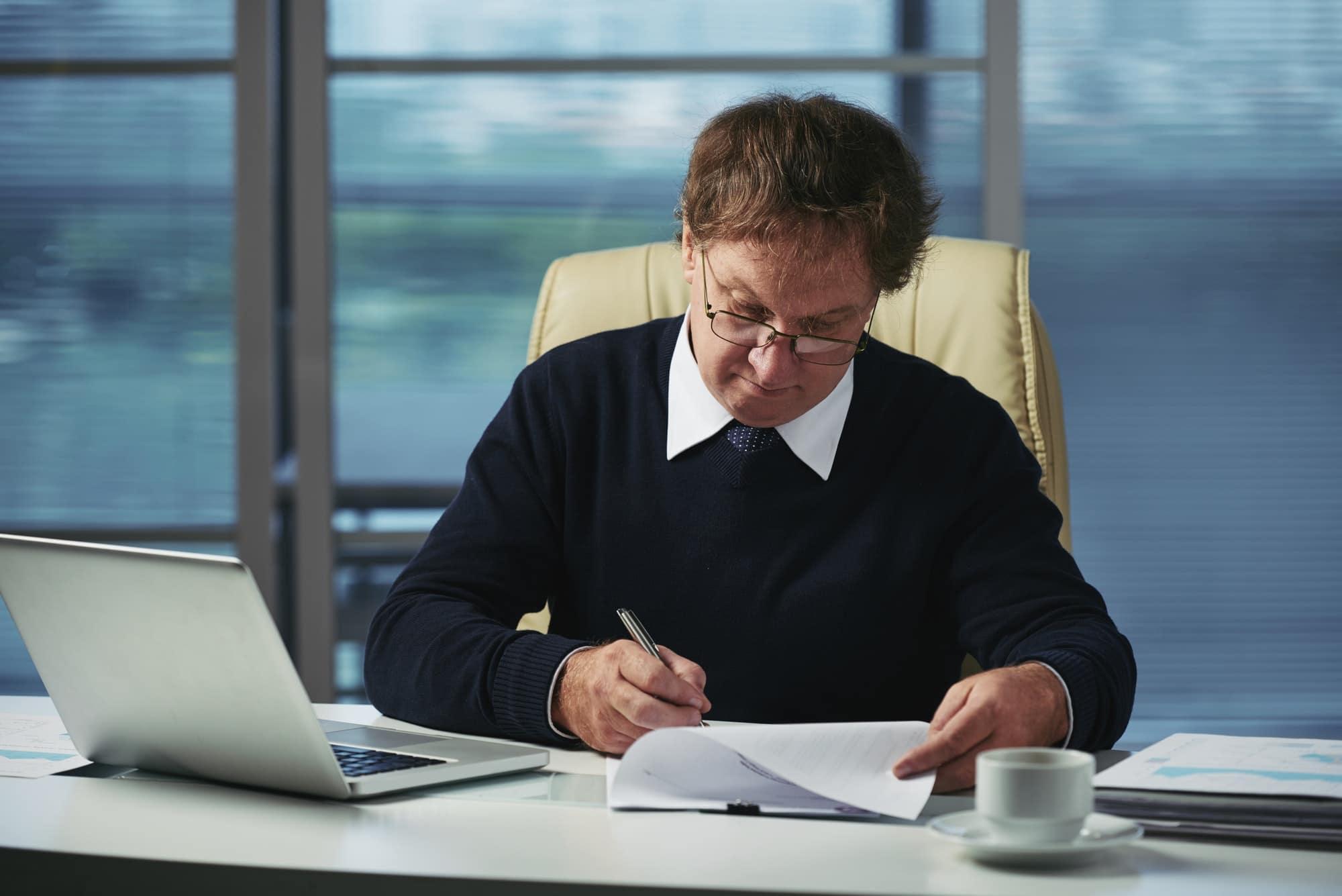 Man at desk working on paperwork